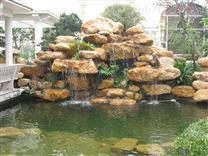 如何设计您的庭院假山鱼池?